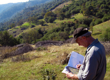Volunteer Karl Mertz checking the map while monitoring at Oest Ranch Lake Clementine Preserve.