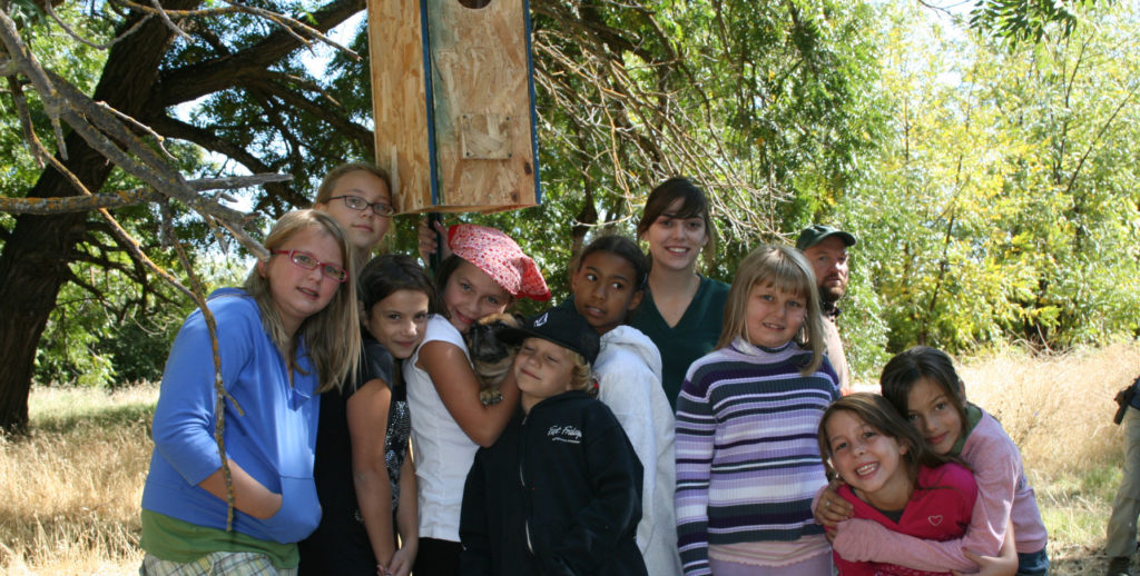 Auburn Elementary School students pose in front of a newly erected bird home.