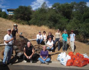 PLT volunteers pose with trash they removed from Sierra Canyon Creek.