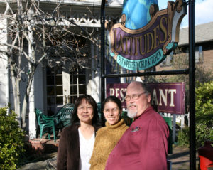 Mehrey Vaghti, PLT's art event chairperson, stands in the middle of Pat & Pete Enochs, owners of Latitudes Restaurant in Auburn.