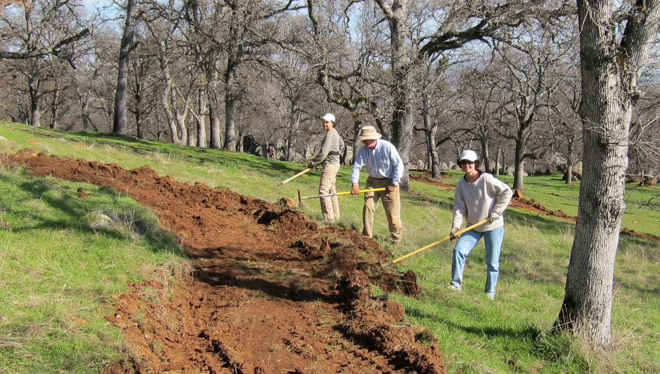 Volunteers working on building trails at Big Hill Preserve